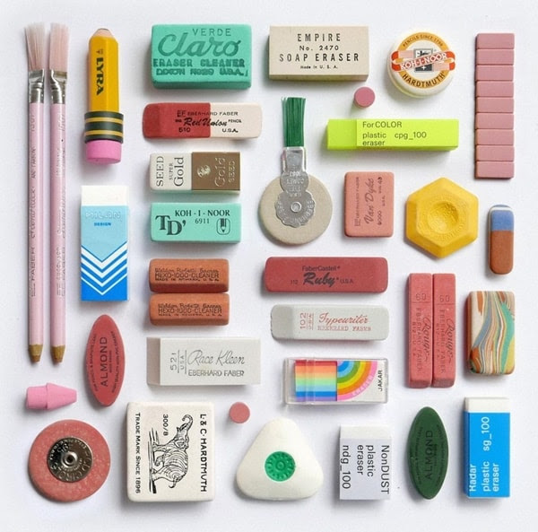 an array of colorful erasers arranged against a white backdrop